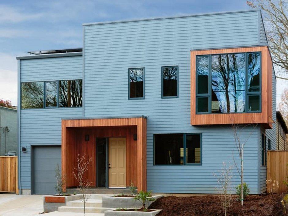 Erker, modernes kubistisches Holzhaus mit farblich abgesetztem Erker im Obergeschoss, Foto: iStock.com / dpproductions