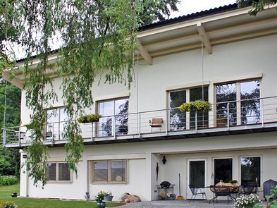 Umbau, Aufstockung, hinterlüftete Fassade, Foto: KitzlingerHaus