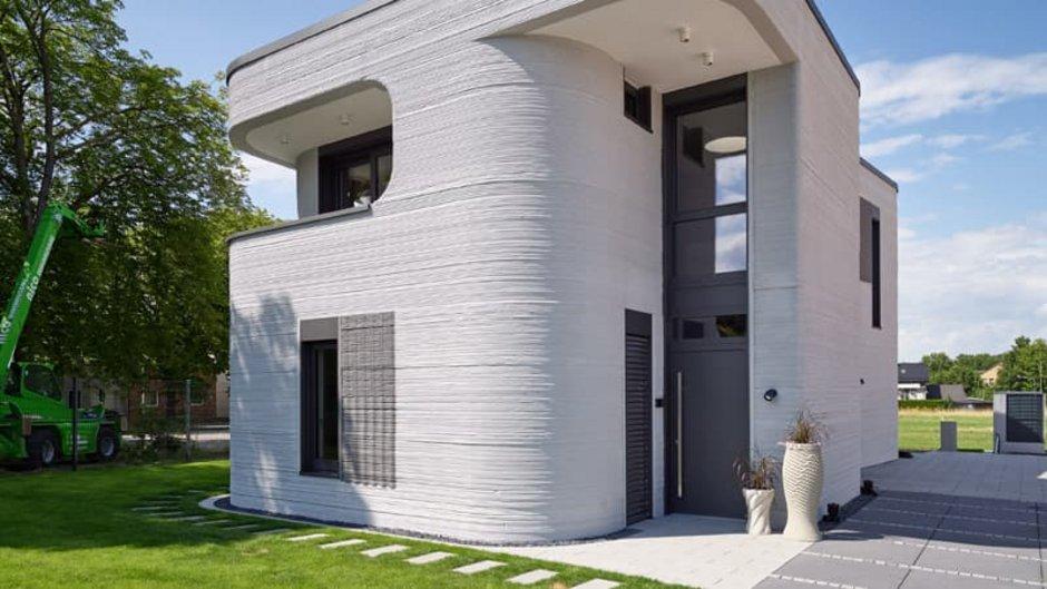 Haus 3D-Drucker, Einfamilienhaus von der Seite fotografiert, kaum Ecken und Kanten, alles abgerundet, Foto: PERI